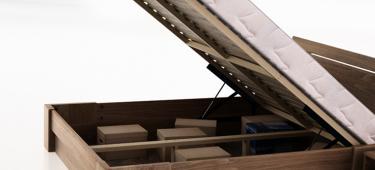 Łóżka z pojemnikiem – co to takiego