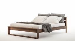 Łóżka drewniane w minimalistycznej sypialni